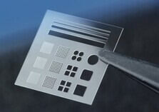 Holes in thin glass manufactured by selective laser-induced etching